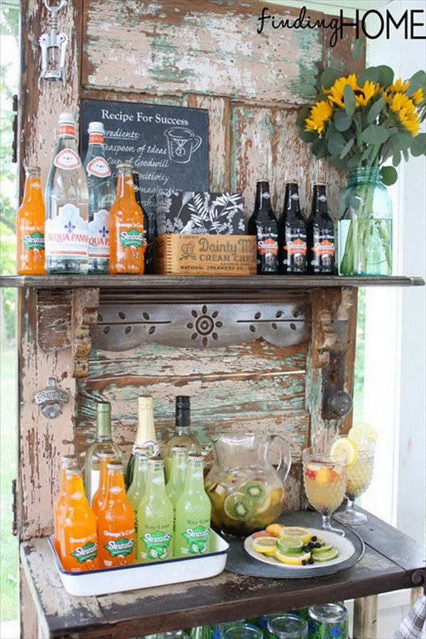 Vintage Door Beverage Bar Station. This idea works perfectly with limited space to serve drinks for the whole crowd.
