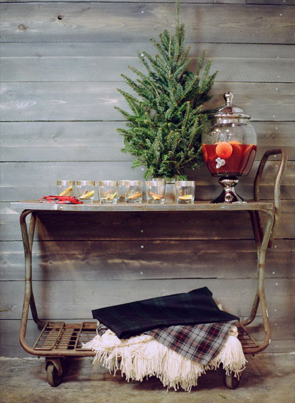 Rolling Drink Cart. Create this rolling drink cart with mini tree, mulled wine cocktail decanter and throw blankets in creamy and cozy plaid tartan down below. This rolling cart drink station is really amazing for its mobile style.