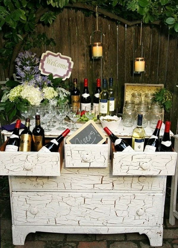 Wine Themed Drink Station. This wine themed drink station is perfect for your wedding celebration with bottles, a cheers sign and the well displayed glassware. This creative beverage station will enable you to incorporate your personalities and passions into your reception decor.