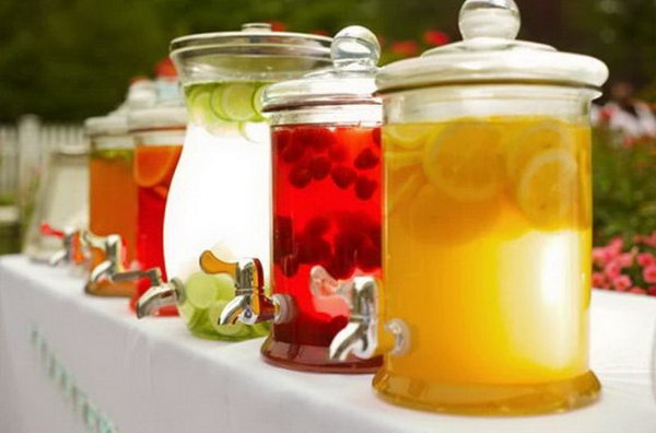 Clearly Cool Summer Drink Station. Bring into play the magic of clear jars en masse by filling them with jewel-bright concoction of your style and matching fruit. Your guests will be impressed by this cool summer flavor with no doubt.