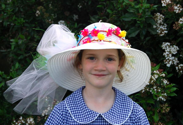 Flower Wreath Easter Hat. Decorate your Easter hat with a beautiful flower wreath, add some flowers, butterflies, beadings and tulle bows to decorate it. It can't be prettier.