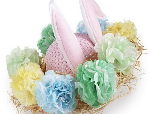 Rabbit Flower Pom Easter Bonnet. Secure raffia around the brim of your bonnet. Attach the ears to your bonnet and decorate it with fuller flower poms made of tissue paper of multi layers.
