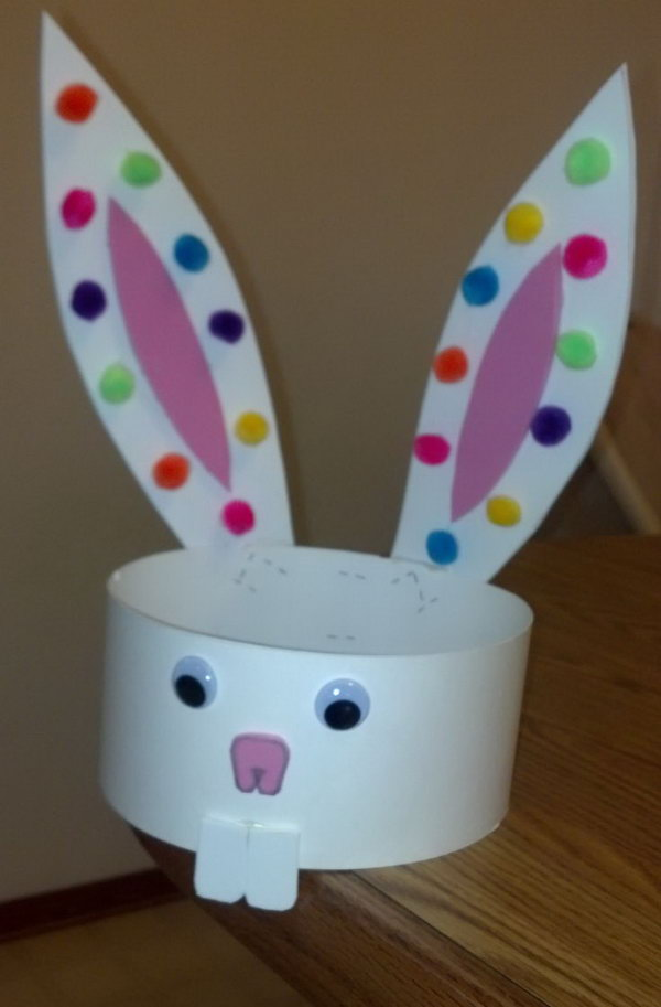 Simple Easter Hat. Make this hat with used buttons instead of pom poms. Make sure that you glue the ears on the back so they would stay straight with extra weight. Try to DIY such a simple Easter hat by yourself. It can bring your kid a lot of fun!