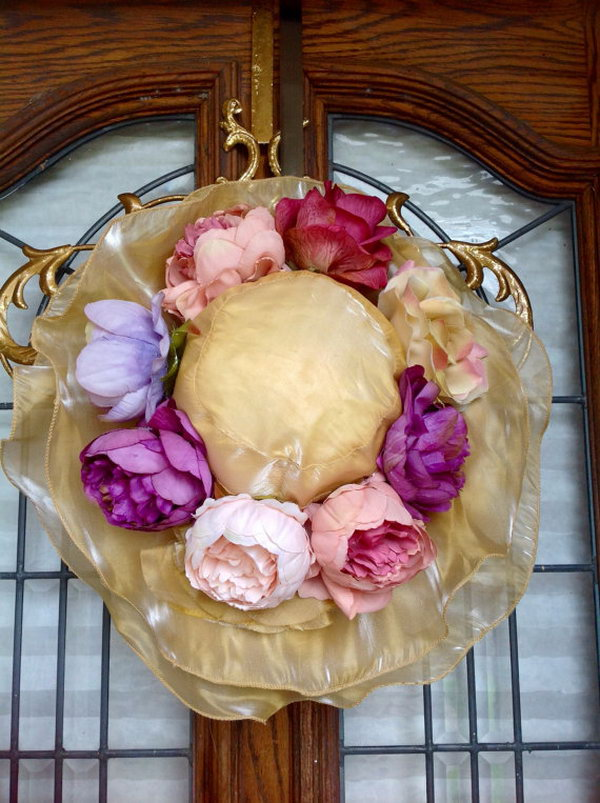 Pretty Floppy Easter Hat with Flowers. This Feminine Women's Easter Bonnet is made from champagne organza with multi layers of sloppy brim. Decorated with vintage roses and peonies, it light up the beauty of a fashionable lady.