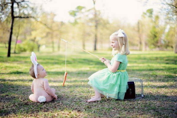 Adorable sibling easter photo the little girl is fishing but she doesnt