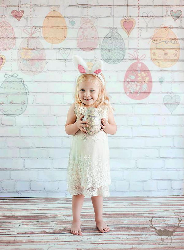 Hanging Easter Eggs on White Brick Backdrop. To catch a nice Easter photo, you need to select a nice scene to match with this festival and sets some mood for it. This white brick backdrop with hanging Easer eggs is a perfect choice.