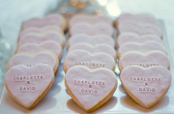 Romantic Personalized Cookies. These heart shaped cookies with the couple's names are really sweet and romantic. Order your personalized cookies with your name together with your lover's name wrote on them for your engagement party. So fantastic.