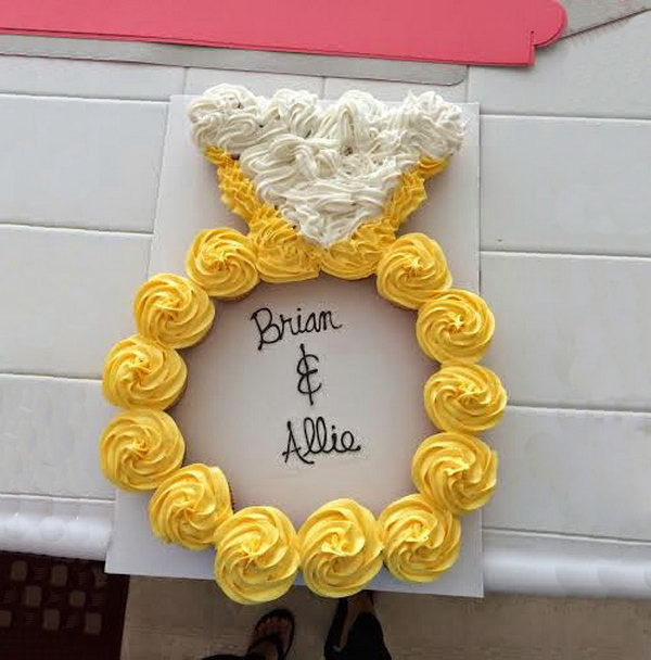 Ring Cake for Engagement Party. Arrange the cupcakes into the ring shape and situate them to fit together tightly. Write down the couple's names using melting chocolate.
