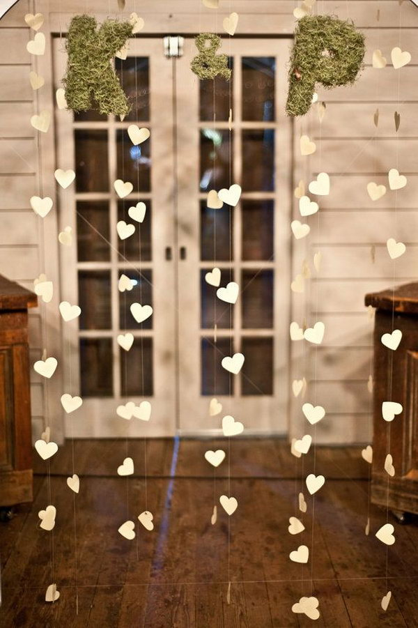 Engagement Party Heart Garland. Thread all the heart shaped cards into a garland. You can paint them in your favorite color. Fasten the moss letters at the top. You can choose 2 letters from the first letter of the couple's last name. It adds a fresh flavor to this garland.