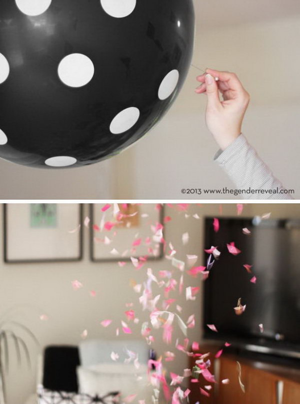 Balloon Confetti Gender Reveal Party. Hang black polka dot balloons to make the great discovery with colorful confetti inside. Discover the gender based on the color of the confetti by popping the balloons.