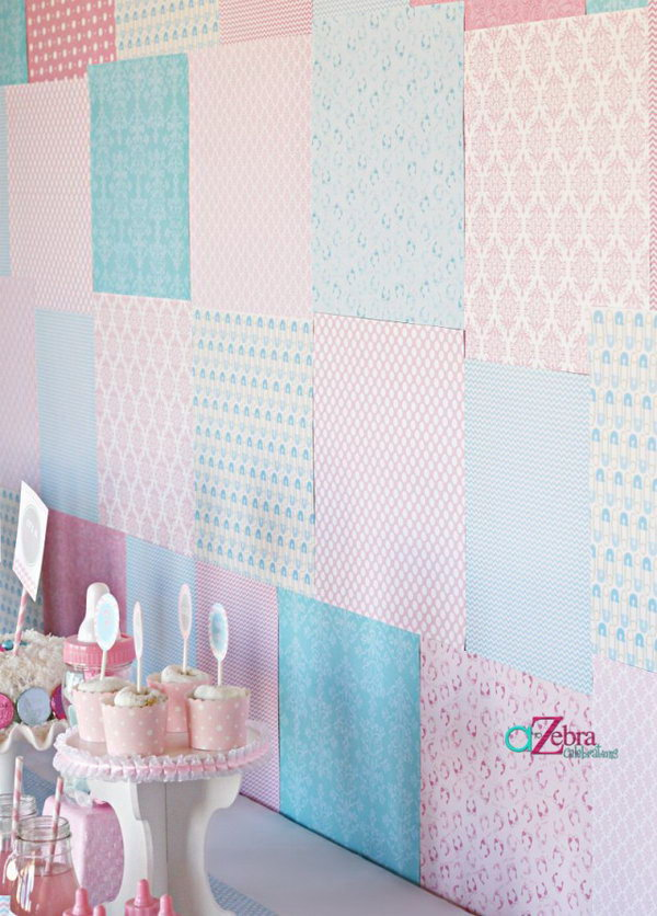 Gender Reveal Backdrop Party Idea. As usual, pink stands for a girl and blue stands for a boy.  Create such a gender reveal backdrop with scrapbook paper in beautiful patterns to get your party dolled up.