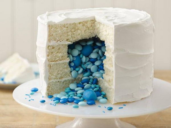 Gender Reveal Cake. Bake a gender reveal cake with a cascade of candy in the appropriate color inside to bring out the exciting news to all your friends and family members.