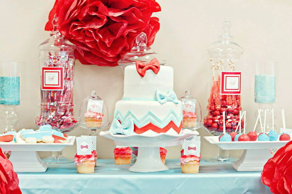 Bow Tie Gender Reveal Party. This adorable bow tie inspired gender reveal party is perfect for the little guy on his way to meet his parents with a good combination of welcome sign with the big read and polka dot bow ties on it, huge apothecary jars, adorable cookies, flower centerpieces, bow tie invitations.