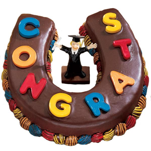 Congratulations All around Cake. Express your heartfelt congratulations to the graduate with this horseshoe shaped cake with chocolate coating and candy letters molding as well as a graduate in center.