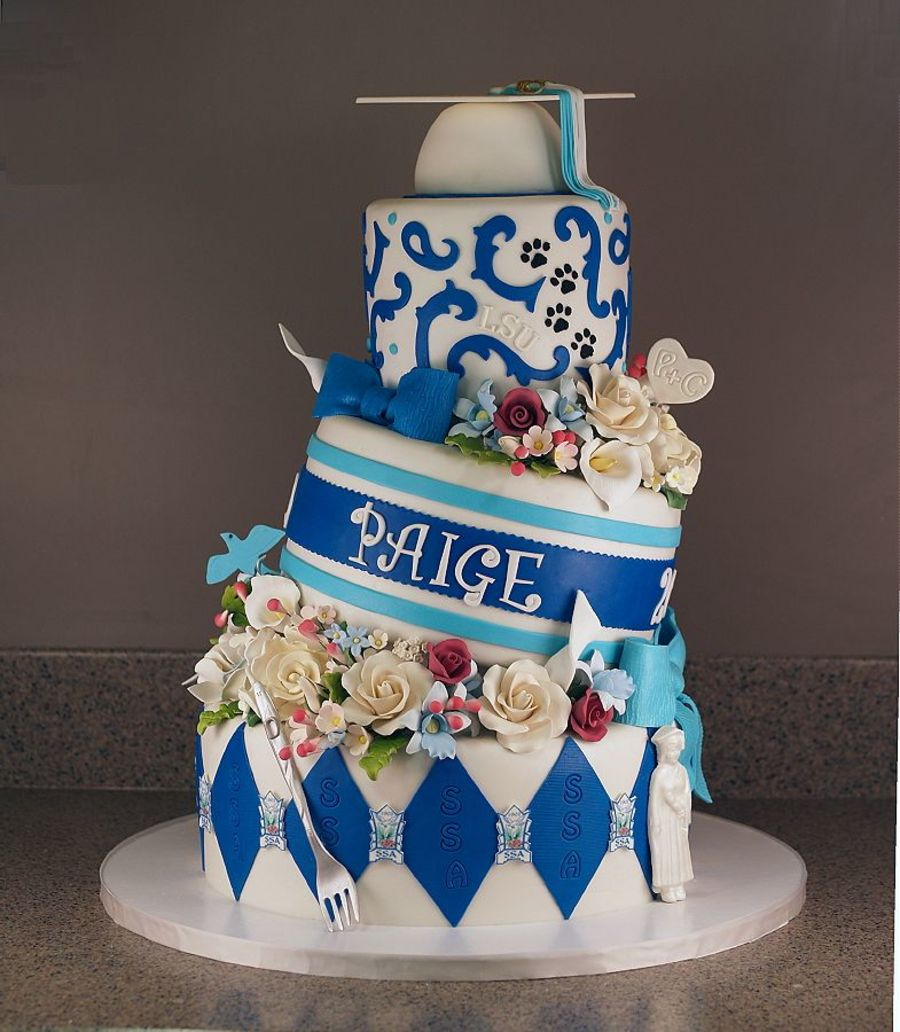 Graduation Tilted Cake. Unlike most graduation cake, this one is especially fun for its tilted outlook. The graduate must adore this gorgeous cake with stunning floral fondant decor, styro ball graduation cap, gumpaste fork as well as edible image logo.