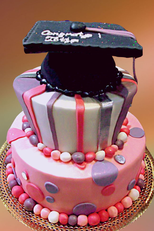 Sweet Graduation Cake. This sweet graduation cake features a big graduation cap at the top. It has strips, polka dots as well as colorful candy balls at side for beautiful garnishment. This graduation cake is super fantastic for a girl.