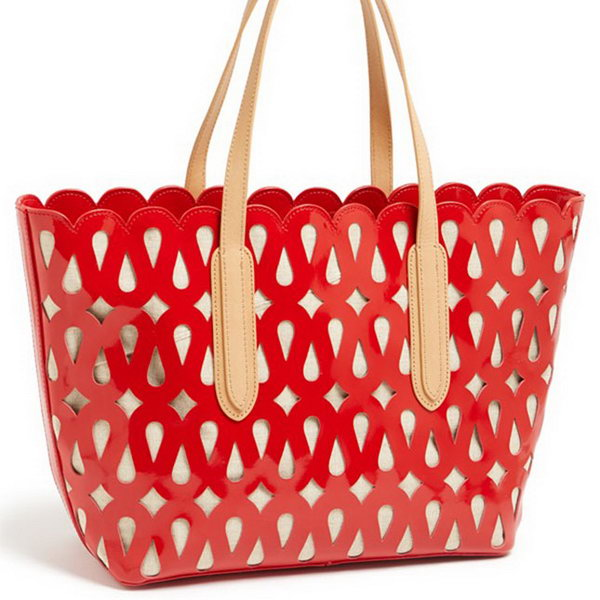 Laser Cut Tote. Stand out your graduation gift from ordinary ones with this laser cut tote. It will definitely spice up your graduate's gift collection for its beautiful design and outlook.