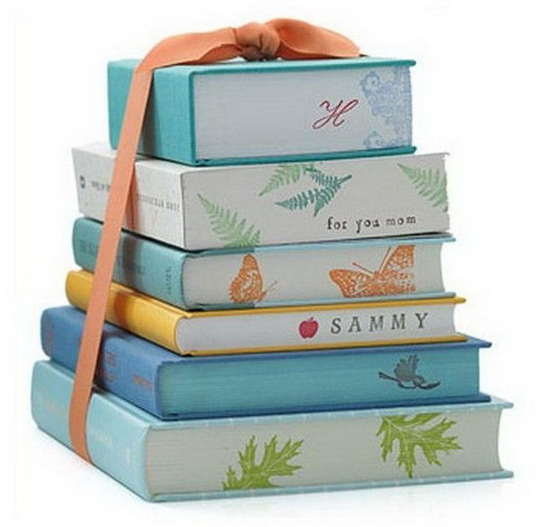 Graduation Party Centerpiece. Design the stacked books with cool, modern gift wrap in colorful prints to coordinate with the theme of you graduation party. You can even decorate the sides with the guest of honor's names.