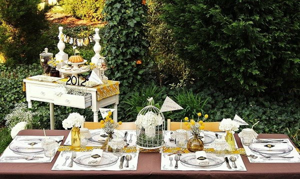 Key to Success Theme. To bring out the key to success theme to the table design, place keys and key holes around the table. The pennants attached to wooden skewers and inserted into the floral arrangements bring a collegiate element for the celebration.