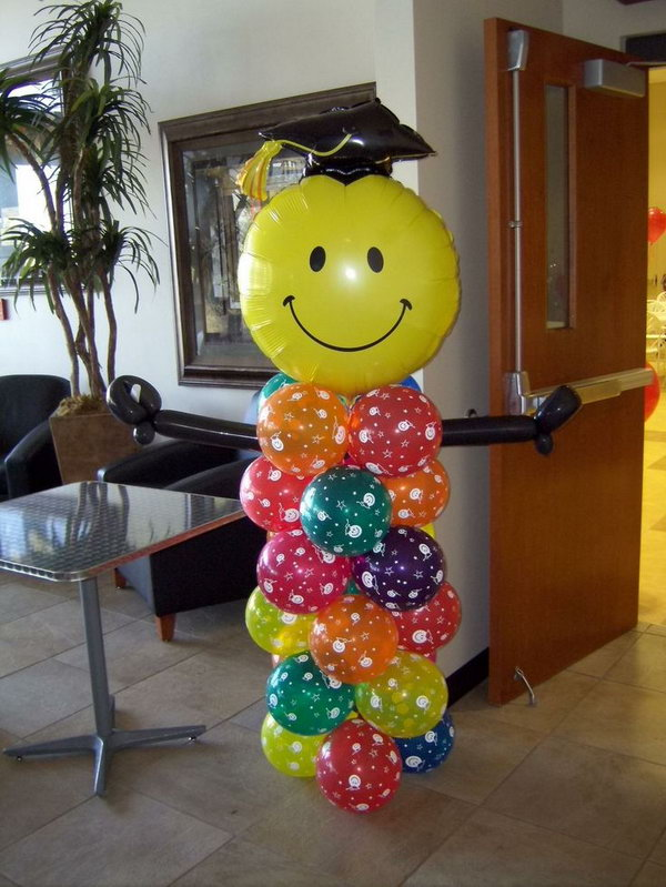Graduation Balloon Decor. This graduation person made out of balloon is really stunning and eye catching. All you need is to put colorful balloons of various shapes together.