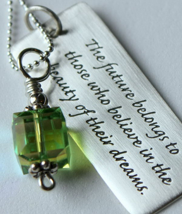 Sterling Silver Graduation Quote Pendant. This pendant features a green cube Swarovski crystal with a silver bali top and a pretty rectangle with the inspirational quote, the future belongs to those who believe in the beauty of their dreams by Eleanor Roosevelt will definitely inspire the graduate to go after his or her dream bravely.