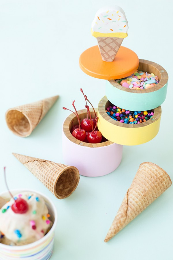 Ice Cream Caddy Party Idea. DIY this ice cream caddy with 3 layers and an ice cream handle at the top. Spread the colorful candy sprinkles in each layer or the caddy. If you are an ice cream fan, this caddy would be perfect for your ice cream themed party.