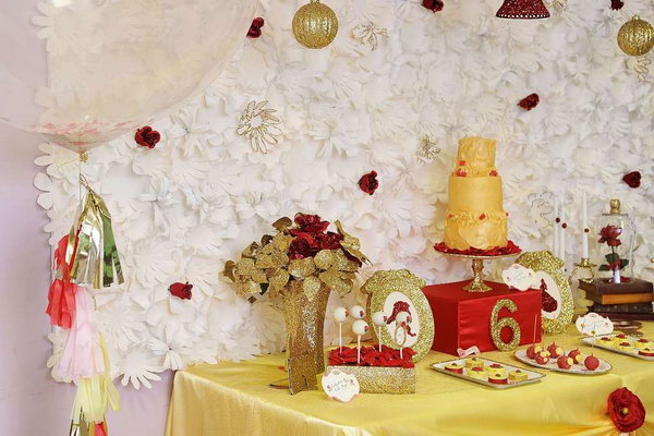 Enchanted Beauty and Beast Party. This beauty and the beast inspiration party consists of sweet desserts, enchanted rose cupcakes, stained glass cookies, cake pops with gold sugar, mini tea cookies. All the favors such as tiaras and wands boys finish off for the theme of this party.