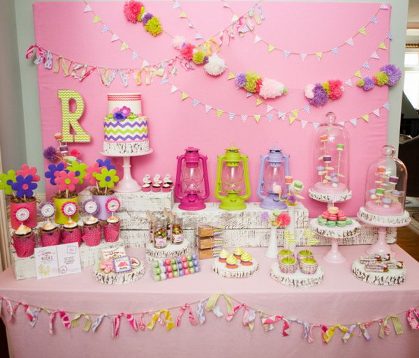 Glam Camping Party. The tassel and pom banner on the backdrop set up the tone for this party. With the glass jars for trail mix, polka dot balloons, lanterns, camp ricki pillowcases décor, it make this camping party an exciting project for you to follow.
