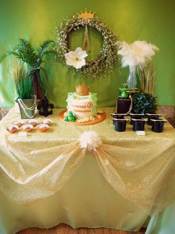 Princess and the Frog Party. This princess and the frog party consists of gold princess crown cake topper, swamp water punch, chocolate party favors, frog shaped embellished cups. The lovely party is full of wonderful ideas to match this theme.