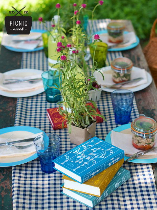 Vintage Summer Party Table Setting. Cover the plastic base with craft paper, display canning jars and floral plants to add up its color and strike the right balance between pretty, special and unfussy.