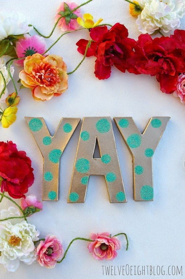 Glittering Letters Floral Garland. Add two coats of spray paint on letters, cover them with polka dot coat as well. Glue beautiful flowers for its pretty outlook. Display your wedding reception with this glittering letters floral garland to impress your guests with a romantic look.