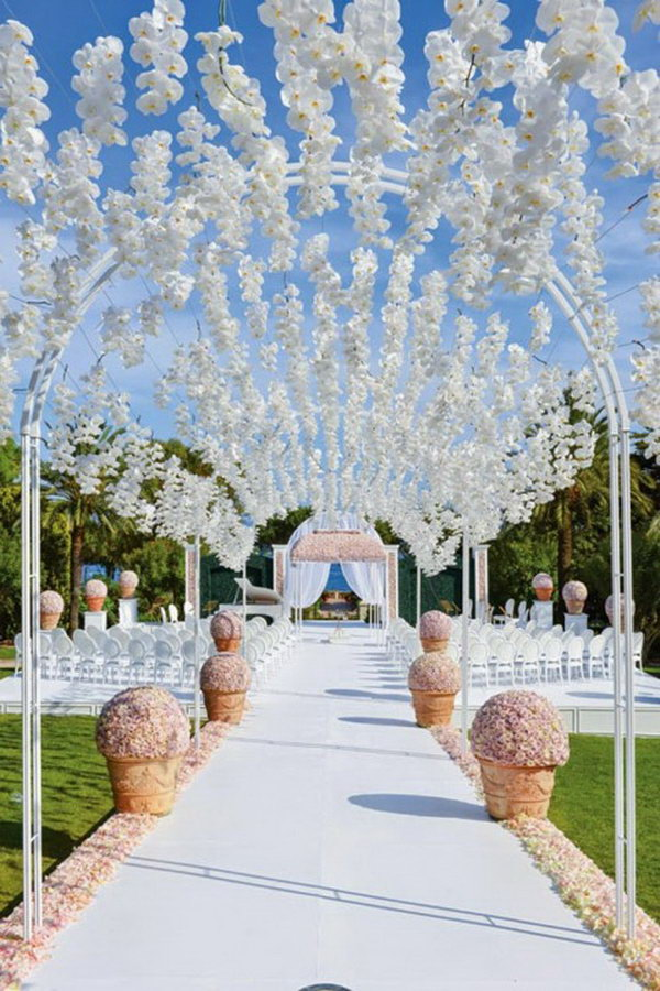 Orchid Archway. Nothing gets more ethereal than this orchid-covered archway for your outdoor wedding decor. It seems as if the petals are magically floating in thin air.