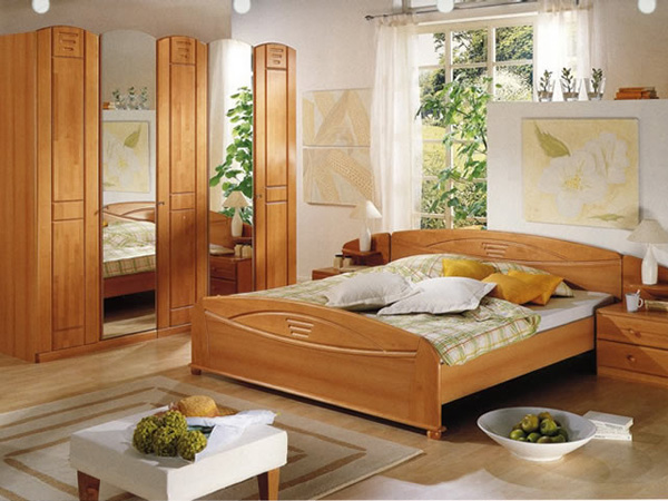Spacious Comfort. Just place one large wooden cupboards to keep all your essentials organized to make your bedroom look spacious and comfortable.