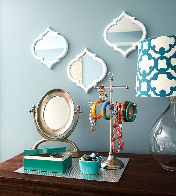 Decorative Storage Idea. This pretty trio of mirrors with a place mat to gather jewelry serve as a charming mix of decorative accents and practical storage.