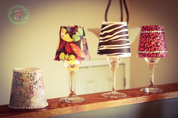 Lovely DIY Lamp. This is a fabulous way to recycle old wine glasses into lovely DIY bling lamp. An old wine glass, some decorative paper, and a battery-operated teat light are all you need to make these crafts. All of these materials can be found at the dollar store. It is perfect for your wedding decor. Get the tutorial here.