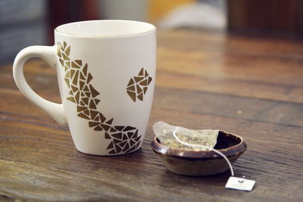 Dollar Store Geometric Decorated Mug. Give the plain white mug from the dollar store a new life by painting a geometric pattern. Of course, you can choose any pattern you like.