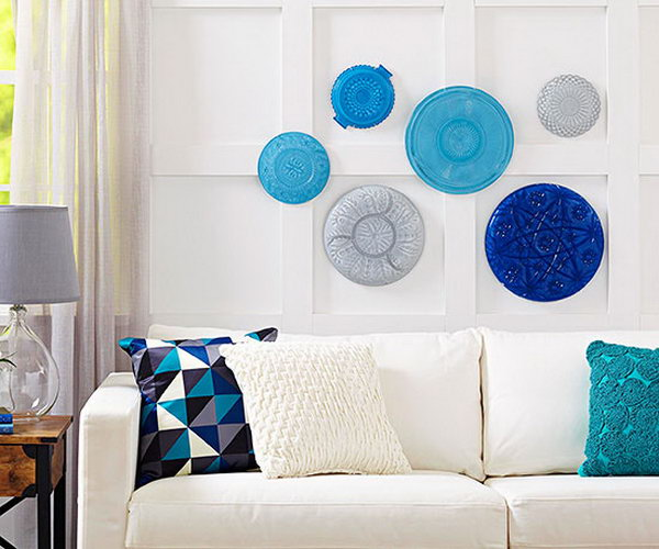 DIY Platter Wall Artwork. It's a fabulous and creative way to turn some crystal platters from the dollar store into a wall artwork.What you need to do is to paint the sides of the platters with some coats of paint in different colors, let them dry.Then match them together according to colors , sizes and patterns, hang them together in the wall.