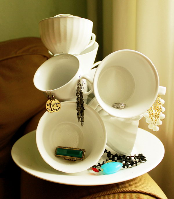 DIY Teacup Sculpture. Glue more teacups from the dollar store to an old plate so there would be more room for your necklaces and other random stuffs. It'll cost you about five bucks. But it adds sort of gorgeous and luxurious atmosphere to your bedroom.