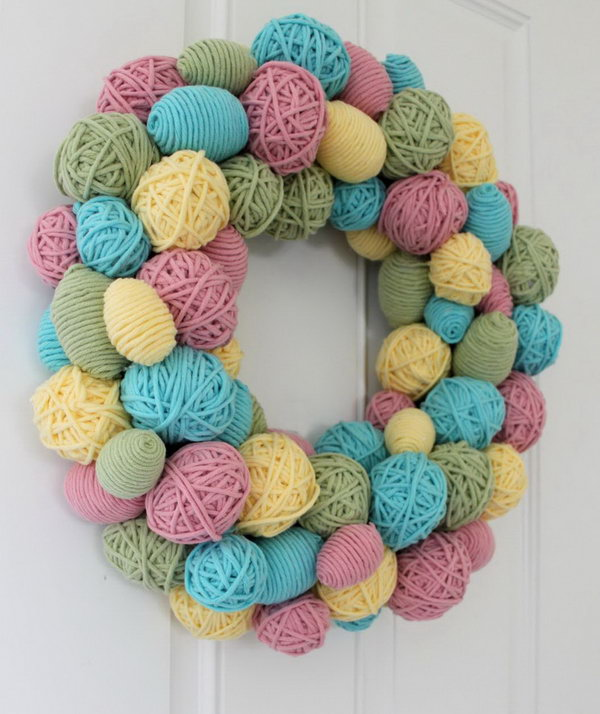 DIY Yarn Egg Wreath. I like this yarn egg wreath very much. They are so adorable. It looks great on the door or used as a party decor. It is also super easy to make. What you need is some yarns in different colors and plastic eggs in various sizes from the dollar store.