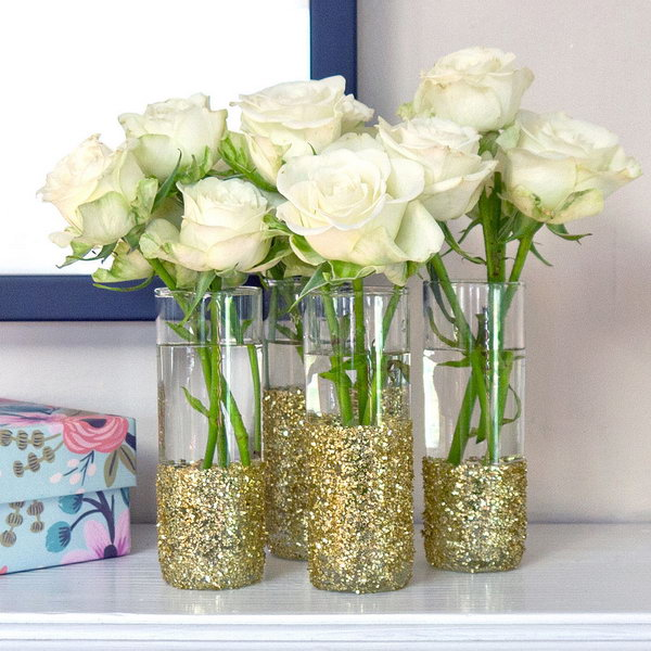 DIY Glitter Shot Glass Vases. These glitter and sparkling shot glass vases with some fresh flowers in are sure to wow your guests as the table accessories for any outdoor entertainment or wedding. See more details here.