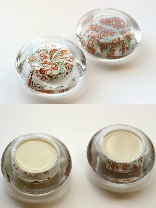 DIY Paperweights from Glass Candle Holders. This is a fun and inexpensive project to reuse old glass jar lids into amazing paperweights. All you need is a little Mod Podge and some pourable resin from the dollar store to set the glass. See the tutorial here.