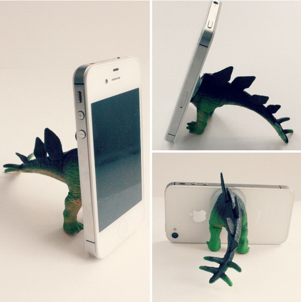 Adorable Dinosaur iPhone Stand. If you have a plastic dinosaur and a few minutes to spare, you can create this inexpensive, unique and fun dinosaur iPhone stand. Check the step-by-step tutorial here.