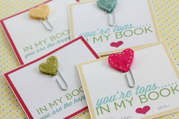Adorable Stitched Heart Bookmarks. Use paperclips, white embroidery thread and colorful fabric to make these adorable stitched-heart bookmarks as perfect gifts to all the book lovers in your life. See the details here.
