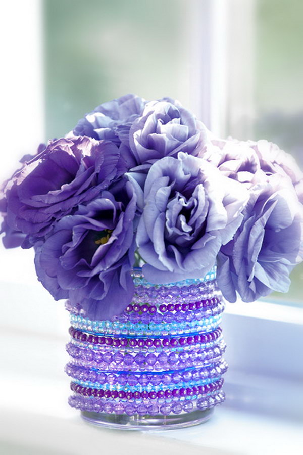 DIY Jeweled Vase. Here is another creative idea to create the custom vases. Dress up a vase, glass, or jar with a few strands of sparkly beads from the dollar store to make this jeweled vase.