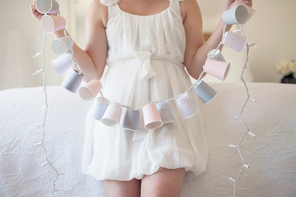 DIY Dixie Cup Garland. Use double side tape and wrap the entire piece around the cup. Cut an X pattern at the bottom to pop in each bulb at the bottom, string along until you complete this garland. It's can illuminate your home with its beautiful decor.