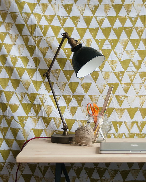Geometric Wall Hanging. Lay plastic tarp below the sheet, dip the surface of triangle bock into the paint to print the patterns on to your color. It's so great to recreate your space in this fashionable way.