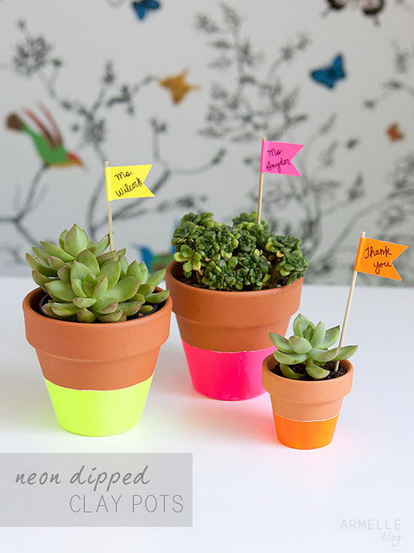 Dipped Succulent Pots. Tape around the entire pot, paint the pot, once it is dry, let the pot dry and plant your fresh plant to add the natural flavor for your dorm room.