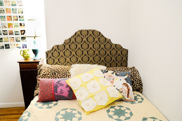 Cut out headboard according to the shape you like, tape the fabric to cover the board completely, hang the headboard behind the bed to add up a beautiful decor for your dorm room.