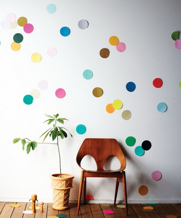 Giant Confetti Wall. Gather a pile of colorful paper, cut all circles out. Glue on the back and arrange all the circles to your imagination to design the beautiful decor for girls' dorm room with various colors.