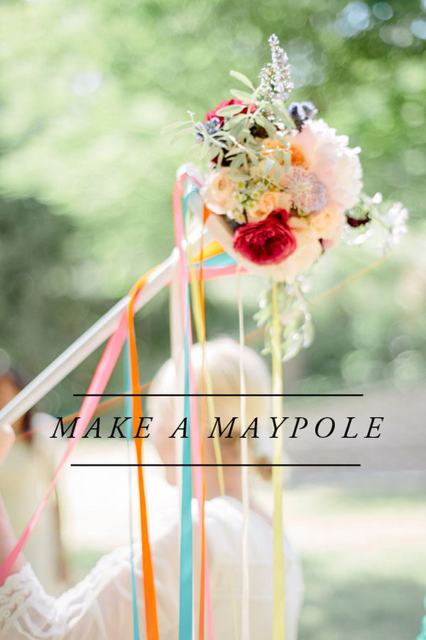 Maypole. Spray paint and add some glue on the top of the metal circle, add flowers and colorful ribbons to create the wonderful artistic floral decor for May.